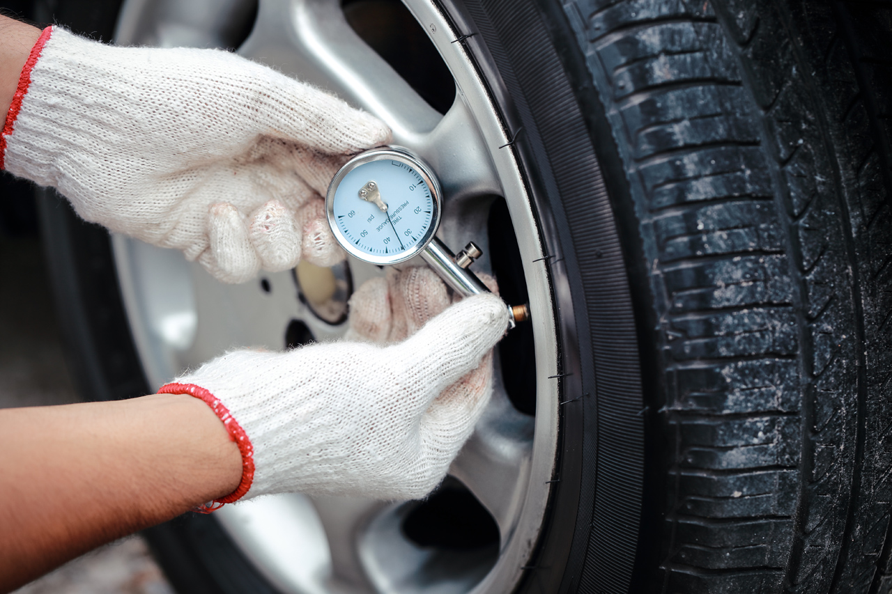 Checking-Tire-Pressure-During-Flat-Tire-Service-Call