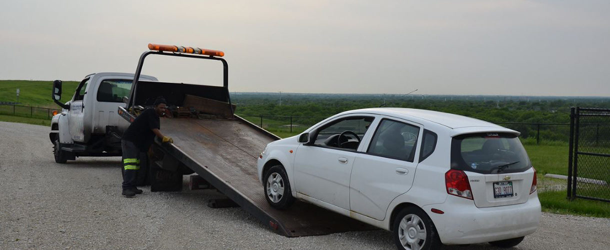 Flatbed-Loading-A-White-Car-On-A-Flatbed-Tow-Truck-Near-Greenfield