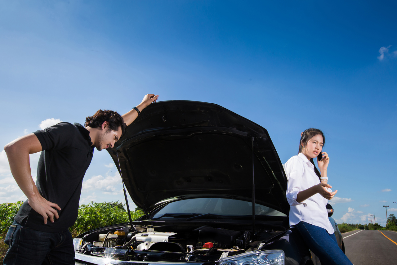 Roadside-Assistance-Call-With-Hood-Open-On-Stranded-Car