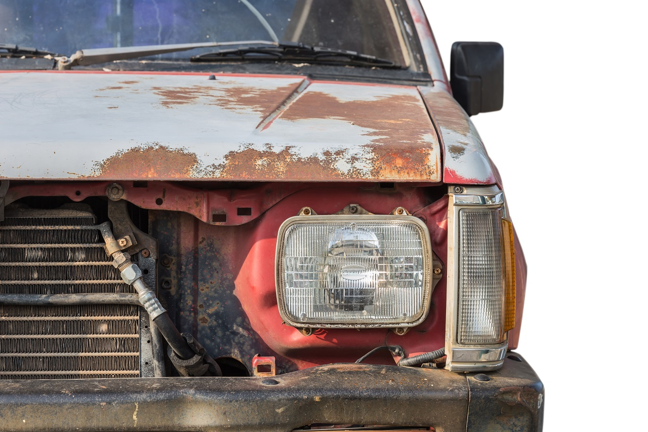 Rusted Front Of A Old Model Car Waiting For A Wrecker Service