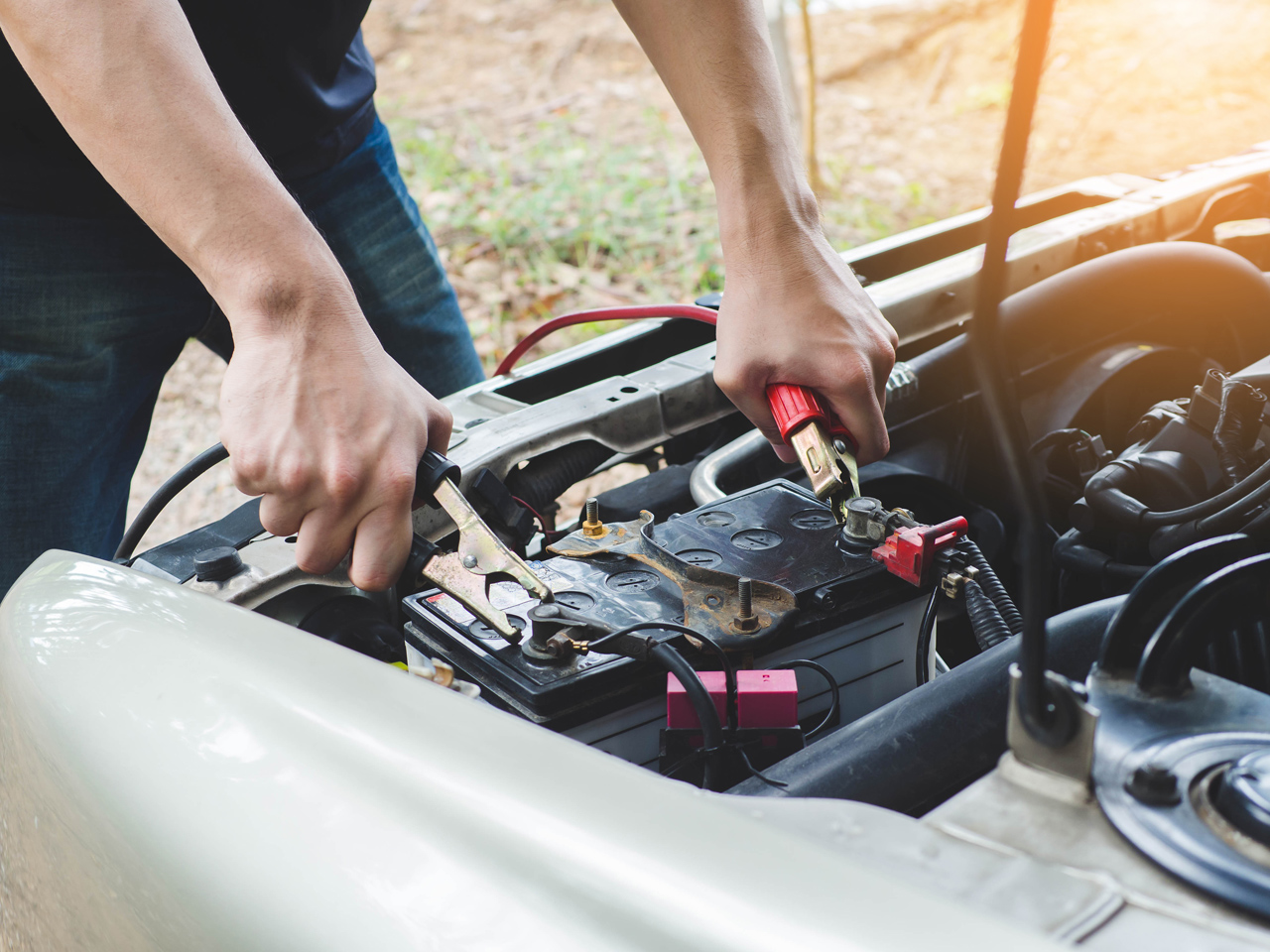 Tow-Driver-Performing-Car-Jump-Start-Serice-On-Battery