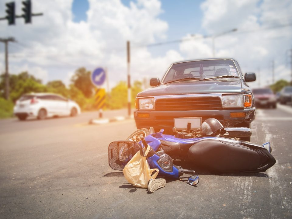 Car accident on a road damaged after colliding with a motorbike